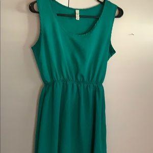 Green scallop back dress